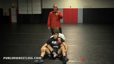 Crossface from a leg ride position