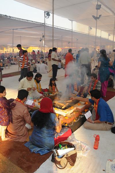 Swami Swaroopanandaji visiting everyone at the 108 havan kunds at Chinmaya Mission Mumbai's Maha Jnana Yajna and 108 Samashti Havan. Chant Mumbai. Shaant Mumbai.Thousands of Mumbaikars came together on Sunday, 15th Feb 2009 to jointly chant 'Hanuman Chalisa', at a congregation called 'Chant Mumbai Shaant Mumbai'. The congregation was organised by Chinmaya Mission at Andheri Sports Complex for the peace and prosperity for the city of Mumbai.