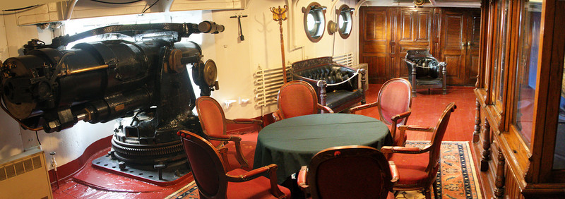 Captains' quarters on the Olympia -- elegance offset by presence of a large side gun