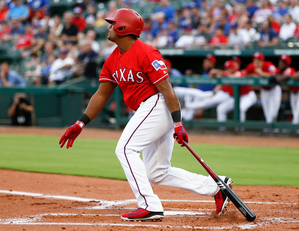 . Texas Rangers\' Adrian Beltre follows through on his RBI-single against the Cleveland Indians during the first inning of a baseball game, Friday, July 20, 2018, in Arlington, Texas. (AP Photo/Jim Cowsert)