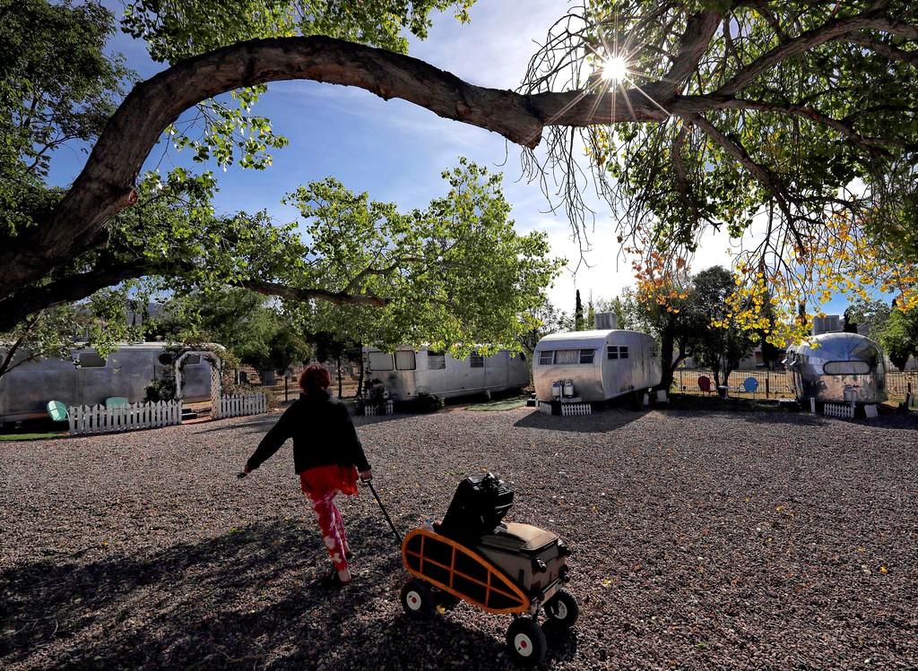 . A guest uses a wagon to move her luggage at the Shady Dell Trailer Court, Wednesday, April 26, 2017, in Bisbee, Ariz. Founded in 1927 as the as the Thompson Motor Court and later renamed the Shady Dell in the 1950\'s, the rest haven nestled in the historic copper mining town was a frequent stop for motorists during the golden age of American automobile travel and is now it\'s own destination for vintage enthusiasts and those seeking a trip out of the ordinary. (AP Photo/Matt York)