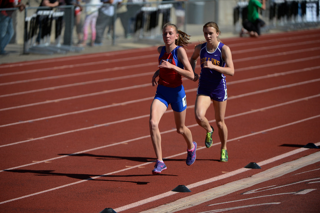 . LAKEWOOD, CO - MAY 16: Jordyn Colter, Cherry Creek High School, left, heads down track with competitor, Erin Hooker, Ft. Collins, only a few feet behind during the girls 5A 3200 meter run final at the 2013 Colorado State Track and Field Championships at Jeffco Stadium May 16, 2013. Hooker eventually overtook Colter on the last lap to win the event. (Photo By Andy Cross/The Denver Post)