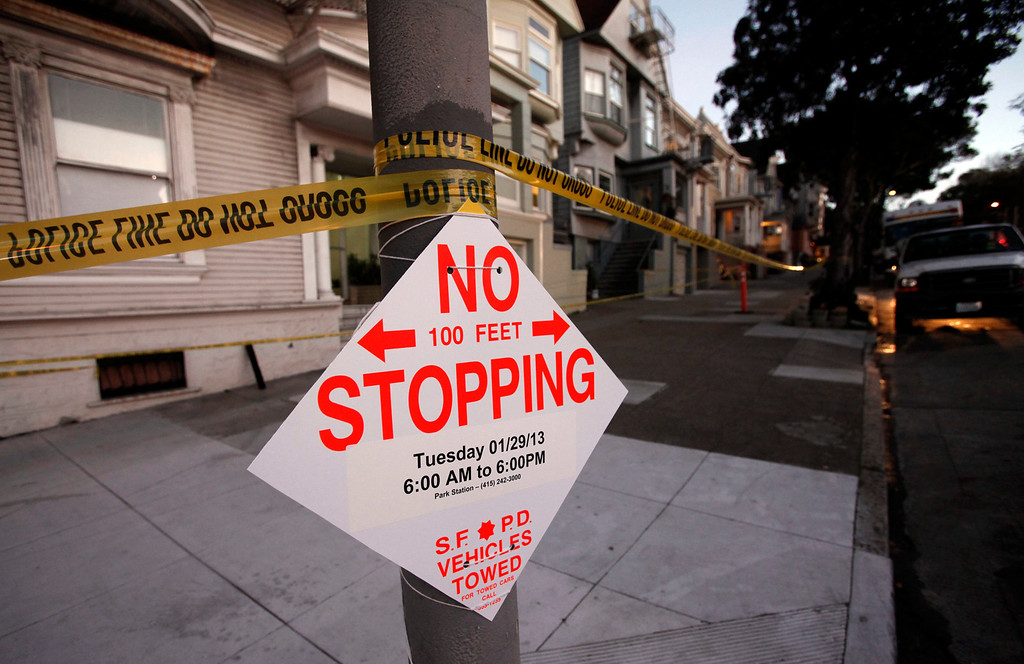 . San Francisco police signs block off the 1100 block of Masonic Avenue Tuesday Jan. 29, 2013 reportedly looking for evidence in the disappearance of 10-year-old Kevin Collins 29 years ago.  (Karl Mondon/Staff)