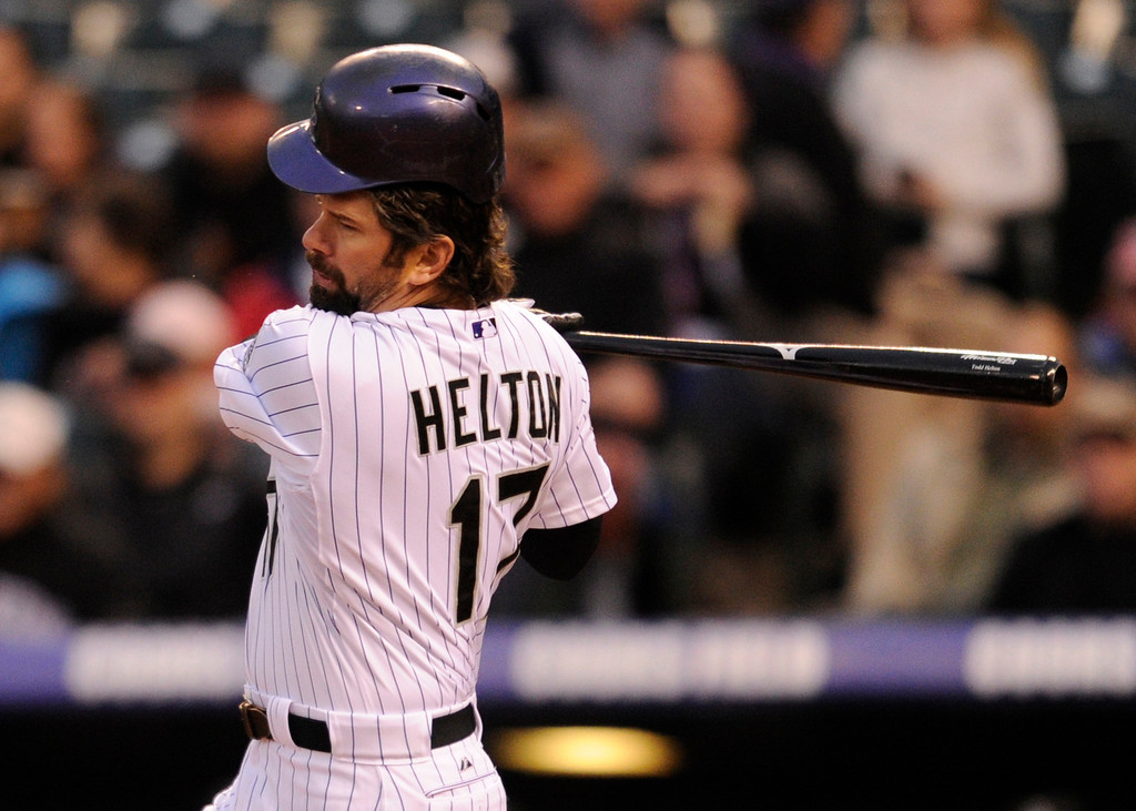 . DENVER, CO. - APRIL 19:  Colorado batter Todd Helton swung so hard at a pitch in the second inning that his helmet popped off his head. The Colorado rockies hosted the Arizona Diamondbacks at Coors Field Friday night, April 19, 2013.  Photo By Karl Gehring/The Denver Post)