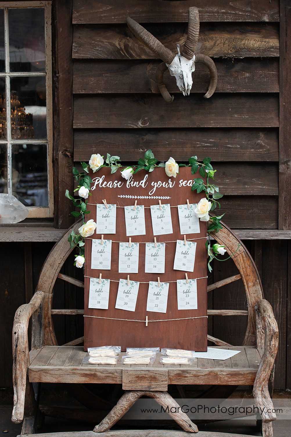 wedding guest name tags on wooden board at Long Branch Saloon & Farms in Half Moon Bay