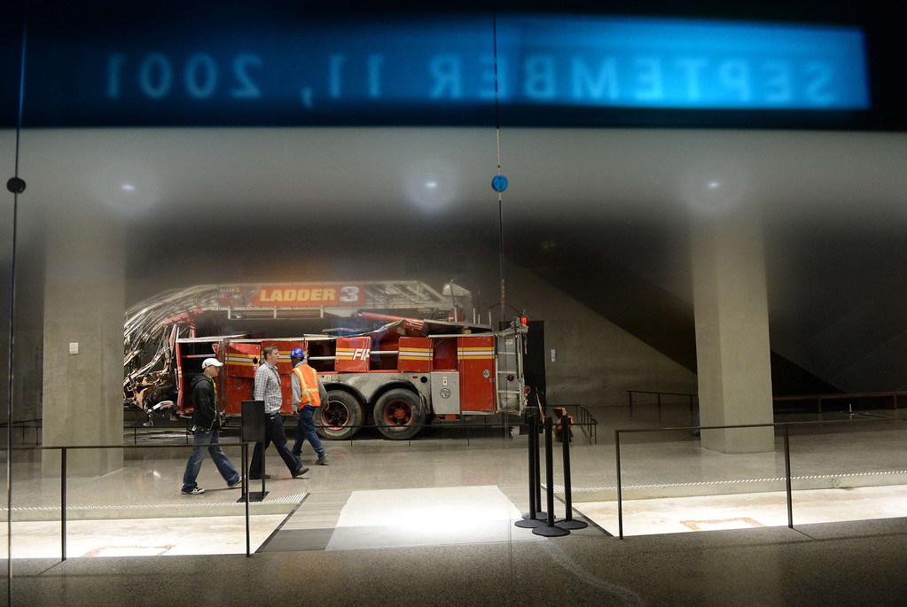 . Remains of a New York City Fire Department Ladder Company 3 truck is seen during a press preview of the National September 11 Memorial Museum at the World Trade Center site May 14, 2014 in New York. AFP PHOTO/Stan HONDA/AFP/Getty Images