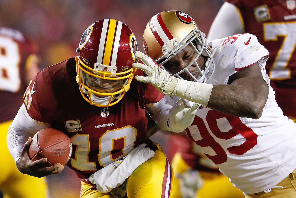 . Washington Redskins quarterback Robert Griffin III is sacked by San Francisco 49ers outside linebacker Aldon Smith during the second half of an NFL football game in Landover, Md., Monday, Nov. 25, 2013. (AP Photo/Evan Vucci)