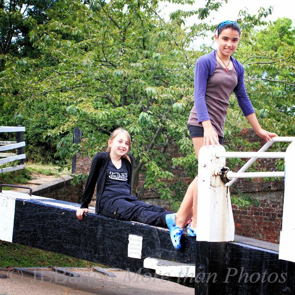 Water Sprites 2011-07-27  These two young people were 'guarding' the lock gate.   They were having fun.   I'm nearing the end of the canal pictures, and have to start on the other trip pictures.  And my new battery charger (Canon) just arrived, so I can go out and take pictures again.  The old one (non-Canon) sizzled and died a week before the end of the trip.  I used my spare battery for the rest of the trip, but it was getting low.