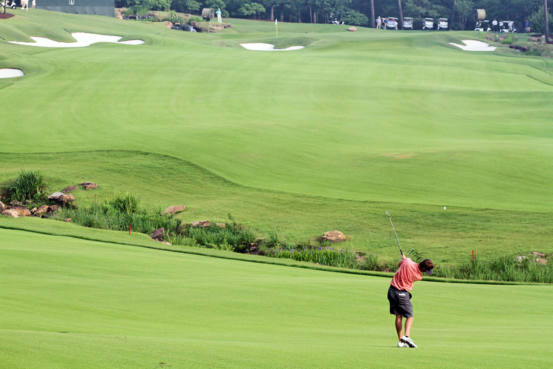 Sean Dale of Jacksonville, FL approaches the 14th green during the championship match of the 111th Western Amateur at The Alotian Club in Roland, AR. (WGA Photo/Ian Yelton)