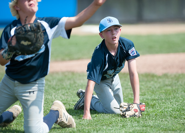08/06/18 Wesley Bunnell | Staff Rhode Island defeated Vermont 10-0 in a 2018 East Regional Little League game in Bristol on Monday afternoon. Vermont pitcher Kevin Dowling (24) watches as first baseman Nick Kelly (14) fields and throws to first.