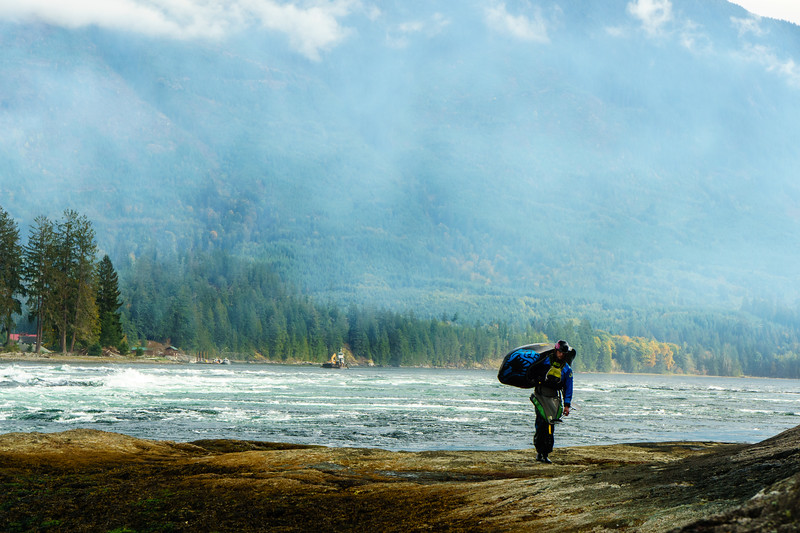 Rob Fusilli walks back up for another surf at Skookumchuck Narrows Provincial Park, British Columbia.