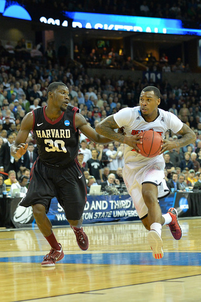 March 20, 2014: Cincinnati Bearcats guard Sean Kilpatrick (23) drives toward the basket during a second round game of the NCAA Division I Men's Basketball Championship between the 5-seed Cincinnati Bearcats and the 12-seed Harvard Crimson at Spokane Arena in Spokane, Wash. Harvard defeated Cincinnati 61-57.