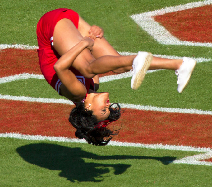 .. and a cheerleader does her celebratory backflips