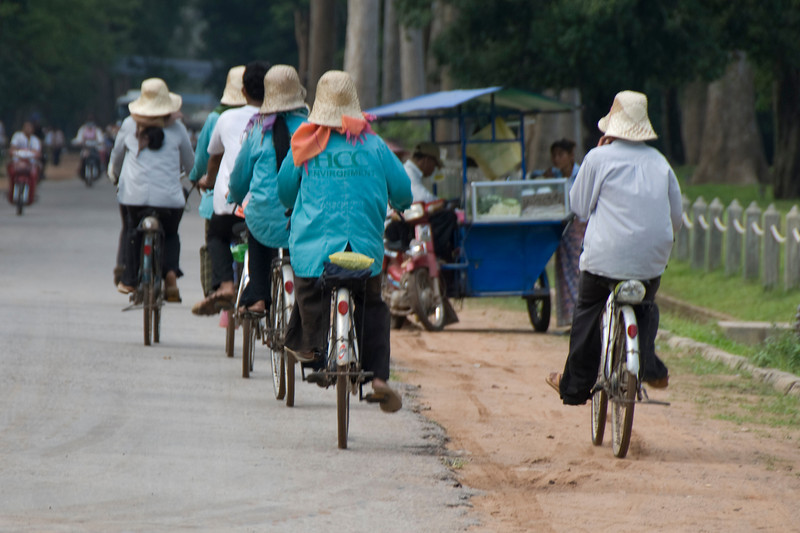 Local bicyclists at Angkor Wat Temple in Cambodia