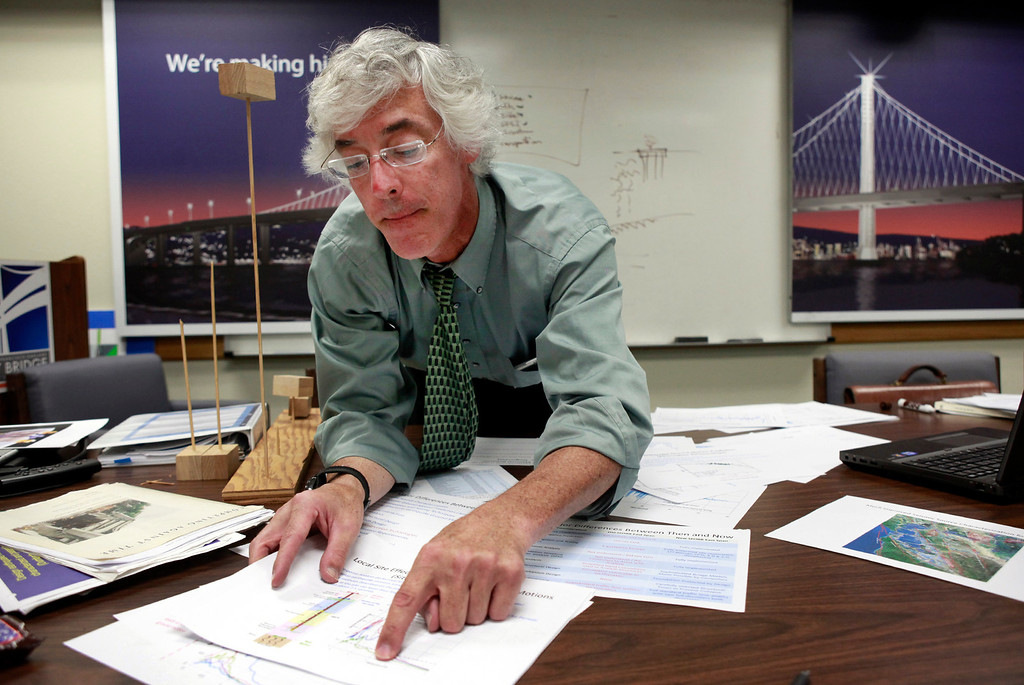 . Caltrans principal bridge engineer Brian Maroney prepares a side-by-side comparison of the old and new eastern spans of the Bay Bridge on Tuesday, July 2, 2013 in Oakland, Calif. Maroney will deliver the presentation to the Bay Area Toll Authority next Wednesday.  (Karl Mondon/Bay Area News Group)