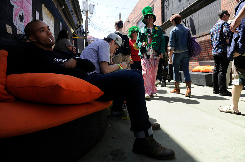 . Stephan Sharps from Boulder relaxes on a set of couches outside during the final day of the first ever High Times US Cannabis Cup at the Exdo Center in Denver on Sunday, April 21, 2013. Seth A. McConnell, The Denver Post