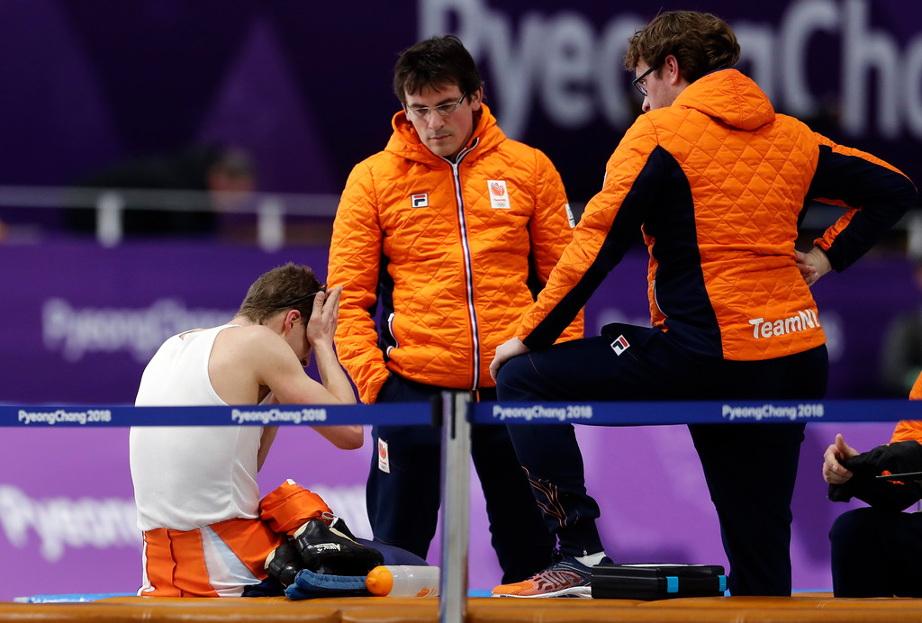 . Sven Kramer of The Netherlands, left, reacts as he sits with his coaches after his performance on the men\'s 10,000 meters speedskating race at the Gangneung Oval at the 2018 Winter Olympics in Gangneung, South Korea, Thursday, Feb. 15, 2018. (AP Photo/Petr David Josek)