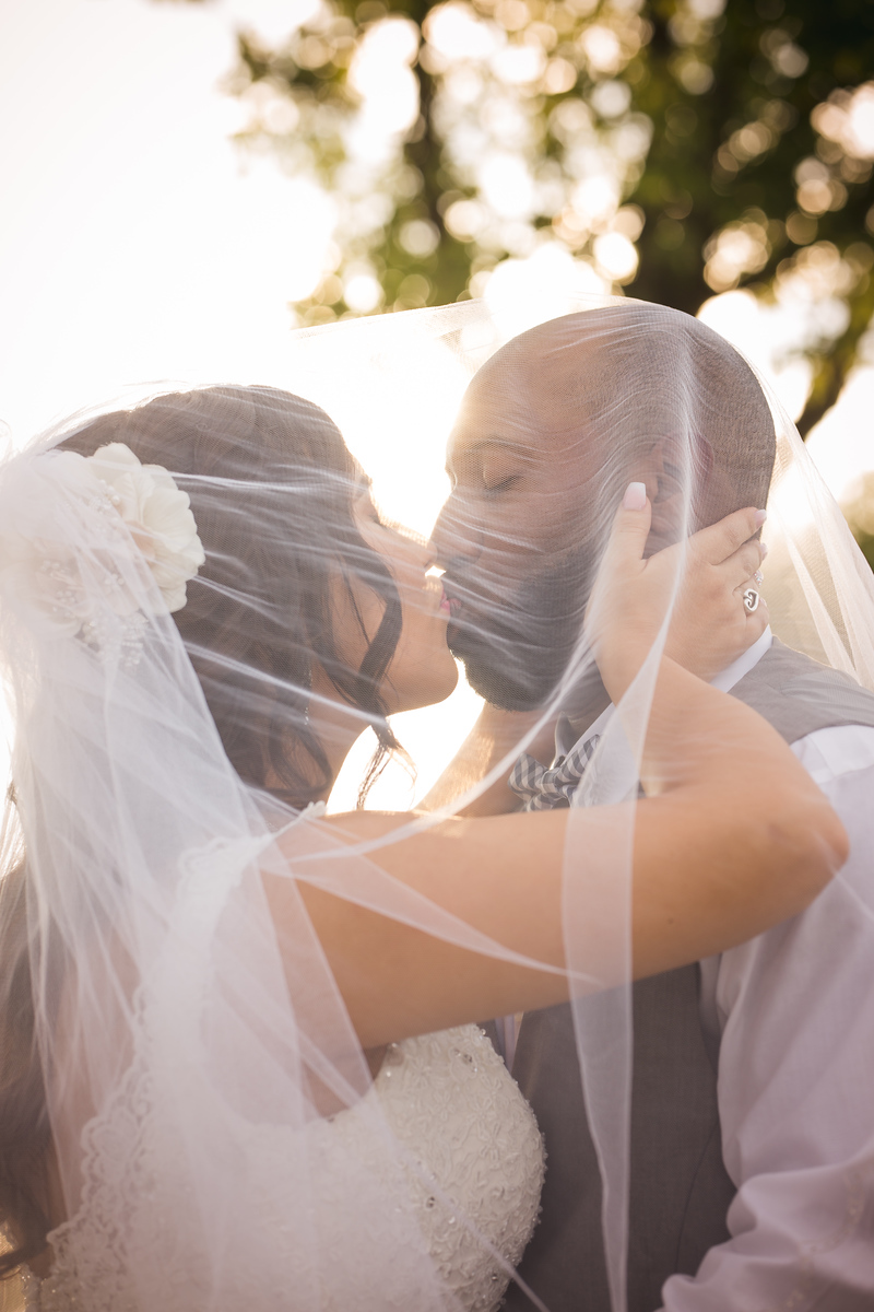 Newlyweds kiss under vail