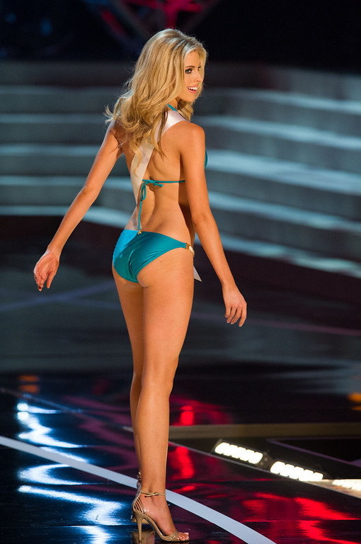 . In this photo provided by the Miss Universe Organization,  Miss Oklahoma USA 2013, Makenzie Muse,  competes in her swimsuit during the  2013 Miss USA Competition Preliminary Show in Las Vegas on Wednesday June 12, 2013.   She will compete for the title of Miss USA 2013 and the coveted Miss USA Diamond Nexus Crown on June 16, 2013.  (AP Photo/Miss Universe Organization, Darren Decker)
