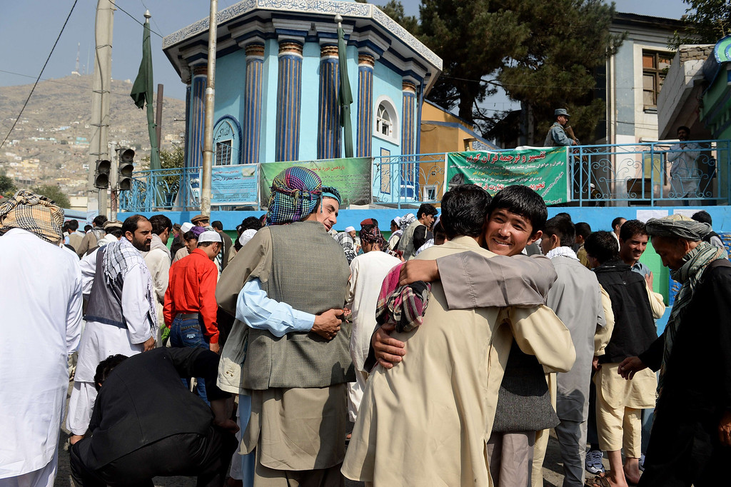 . Afghan Muslims hug each other after performing prayers to celebrate Eid al-Fitr and the end of the fasting month of Ramadan at the Shah-e Do Shamshira mosque in Kabul on August 8, 2013. Muslims around the world are celebrating Eid al-Fitr this week, marking the end of the holy month of Ramadan during which followers are required to abstain from food, drink and sex from dawn to dusk. SHAH MARAI/AFP/Getty Images