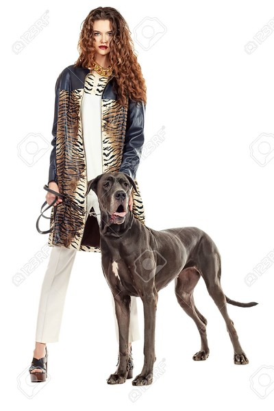 20198512-beautiful-young-woman-posing-with-her-great-dane-dog-isolated-over-white-.jpg