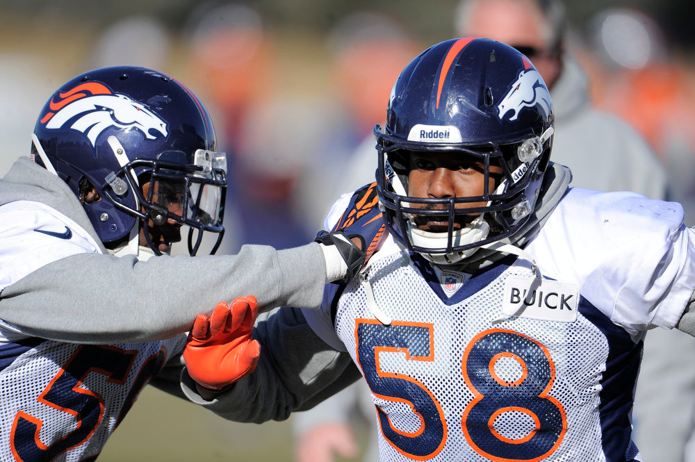 . Denver Broncos outside linebacker Von Miller (58) runs through drills during practice Wednesday, January 2, 2013 at Dove Valley.  John Leyba, The Denver Post