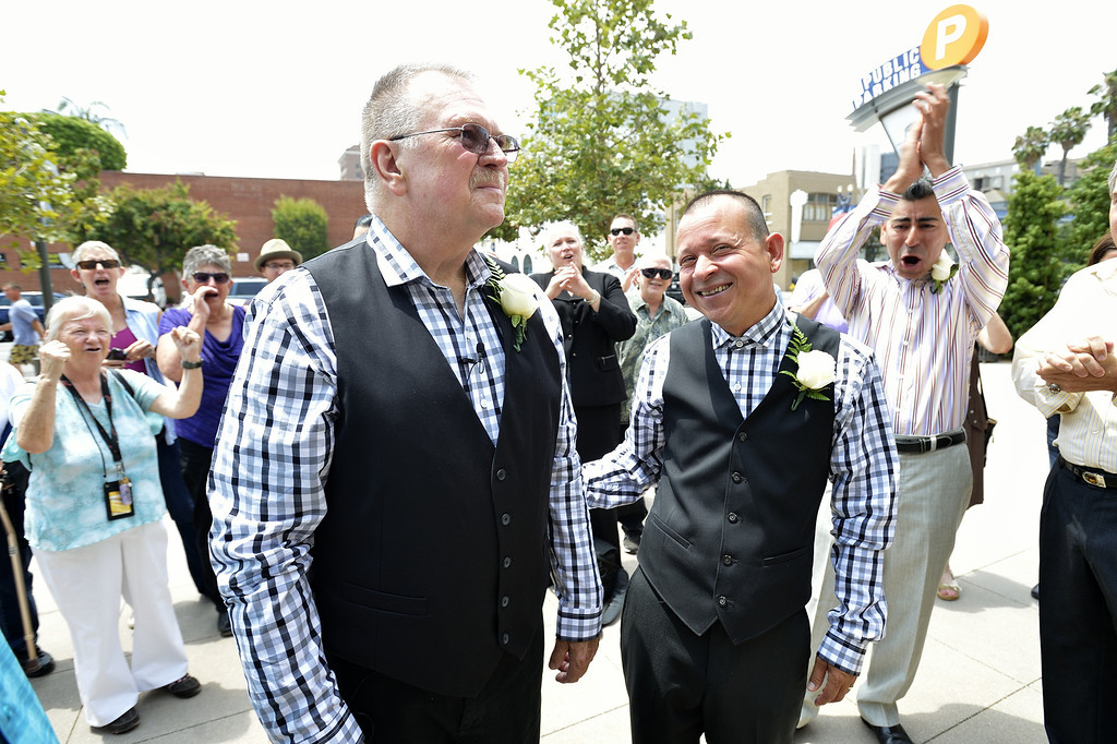 . LONG BEACH, CALIF. USA -- Long Beach residents Bob Crow, left, and Tony Almeida, celebrate after getting married at Harvey Milk Plaza in Downtown Long Beach, Calif., on July 1, 2013. Long Beach Mayor Bob Foster performed the marriage ceremony for the couple. Crow, who founded Long Beach Pride, asked Foster to perform the ceremony years ago.  Photo by Jeff Gritchen / Los Angeles Newspaper Group