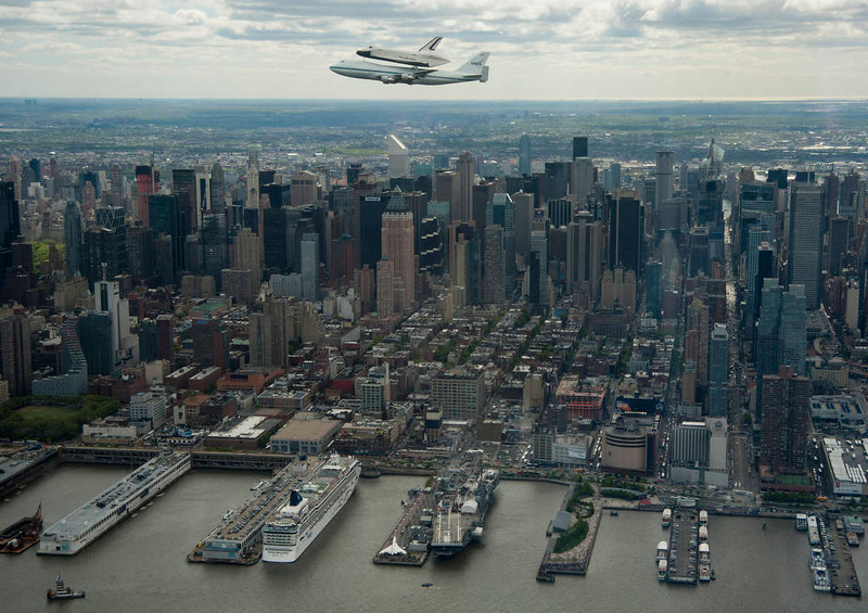 . This photo provided by NASA shows space shuttle Enterprise, mounted atop a NASA 747 Shuttle Carrier Aircraft (SCA), flying near the Intrepid Sea, Air and Space Museum on April 27, 2012, in New York. Enterprise was the first shuttle orbiter built for NASA performing test flights in the atmosphere and was incapable of spaceflight. Originally housed at the Smithsonian\'s Steven F. Udvar-Hazy Center, Enterprise will be demated from the SCA and placed on a barge that will eventually be moved by tugboat up the Hudson River to the Intrepid Sea, Air and Space Museum in June.          AFP PHOTO/NASA/Robert Markowitz/HO       /AFP/Getty Images