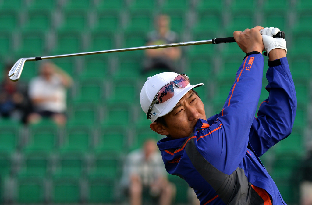 . South Korea\'s Jang Dong-Kyu watches his shot from the 4th tee during his second round, on day two of the 2014 British Open Golf Championship at Royal Liverpool Golf Course in Hoylake, north west England on July 18, 2014. PAUL ELLIS/AFP/Getty Images