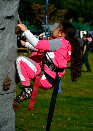 10/5/2019 Mike Orazzi | StaffrAnasti Resto,5, attempts the climbing wall during Main Street USA in Walnut Hill Park in New Britain on Saturday.