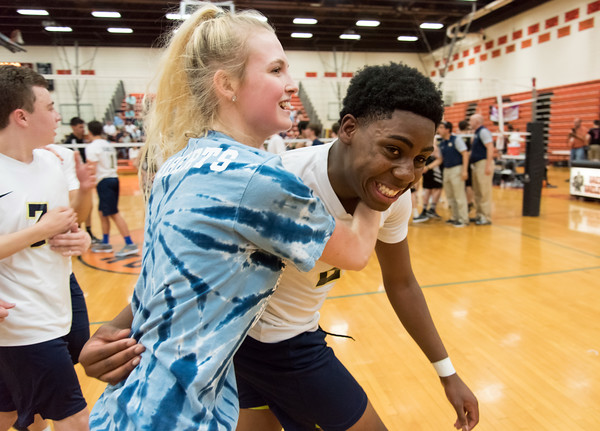 06/07/18 Wesley Bunnell | Staff Newington volleyball defeated Joel Barlow on Thursday night at Shelton High School to claim the Class M State Championship. Meghan Roberts runs onto the court to hub Louis Egbuna (2) after the win.
