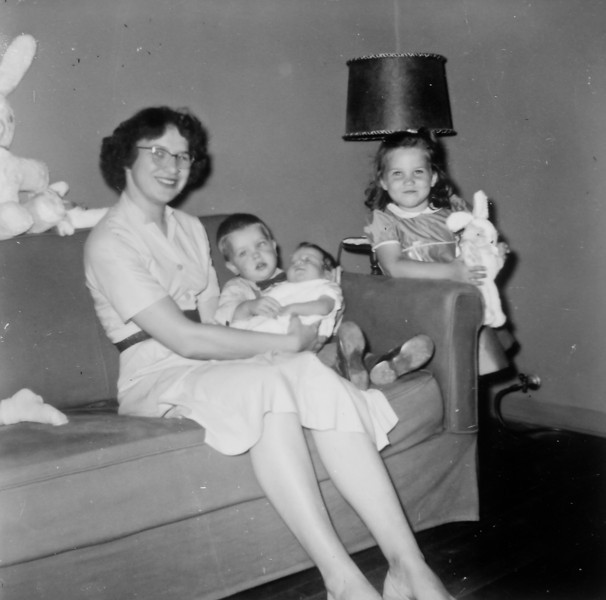 Maria Smock with Jim. Jeanne and Barbara Wick Easter 1955
