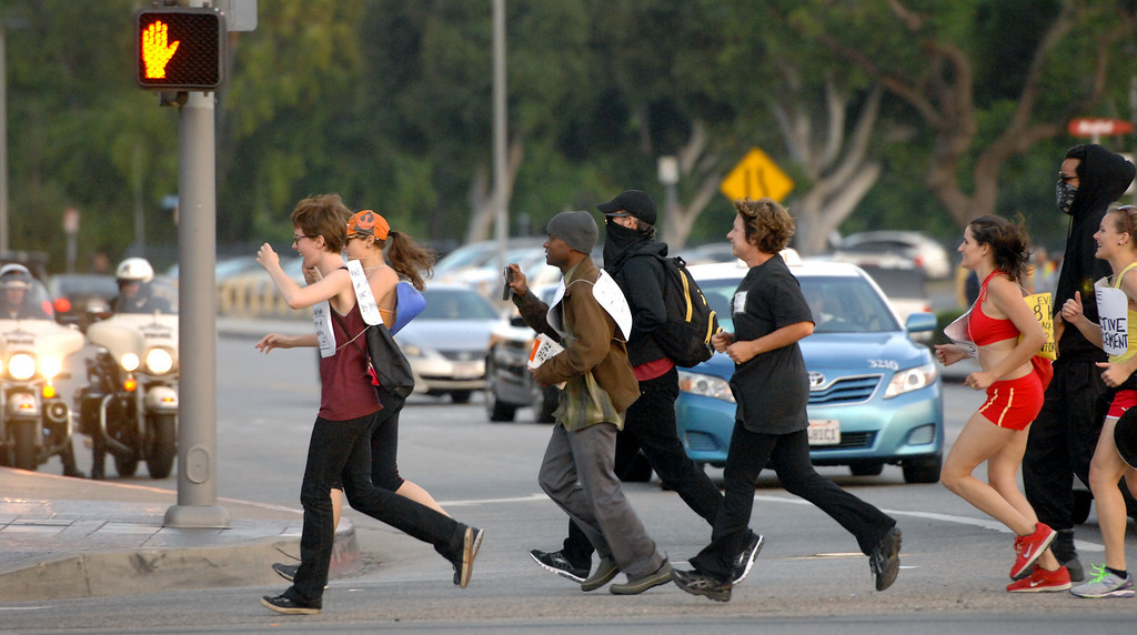 """. Protesters jog along Wilshire Boulevard in Westwood during a \""""Smash White Supremacy Fun Run,\"""" Thursday, July 18, 2013. (Michael Owen Baker/L.A. Daily News)"""