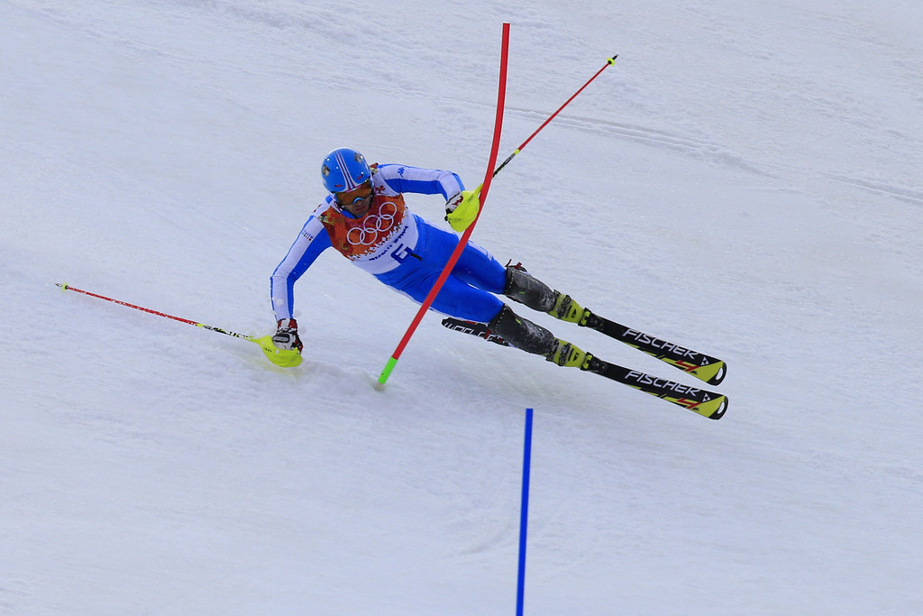 . Italy\'s Patrick Thaler falls during the Men\'s Alpine Skiing Slalom Run 1 at the Rosa Khutor Alpine Center during the Sochi Winter Olympics on February 22, 2014.  ALEXANDER KLEIN/AFP/Getty Images
