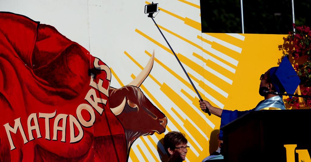 . Valedictorian Brandon Eng takes a selfie prior to his speech during the La Mirada graduation at La Mirada High School in La Mirada, Calif., on Tuesday, June 16, 2015. (Photo by Keith Birmingham/ Pasadena Star-News)