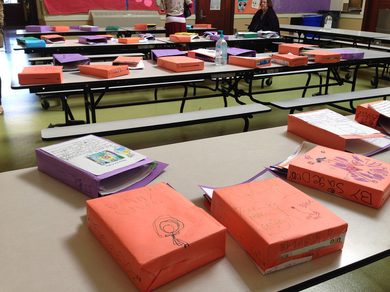 """Amelia's """"Writer's Celebration"""" at school. Each kid reads their stories aloud. Amelia's box is the purple one on the near table."""