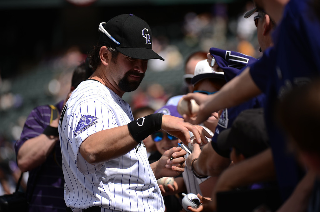 . Todd Helton (17) of the Colorado Rockies signs autographs before the start of the first inning (Photo by Hyoung Chang/The Denver Post)
