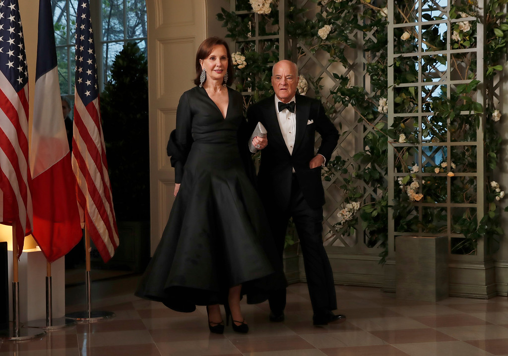 . Henry Kravis and Marie-Josée Kravis arrive for a State Dinner with French President Emmanuel Macron and President Donald Trump at the White House, Tuesday, April 24, 2018, in Washington. (AP Photo/Alex Brandon)