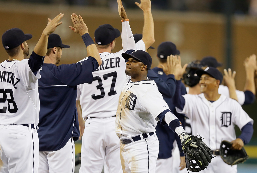 . Detroit Tigers center fielder Rajai Davis leads his teammates in celebration of their 4-2 win over the Colorado Rockies in an interleague baseball game, Friday, Aug. 1, 2014, in Detroit. (AP Photo/Carlos Osorio)