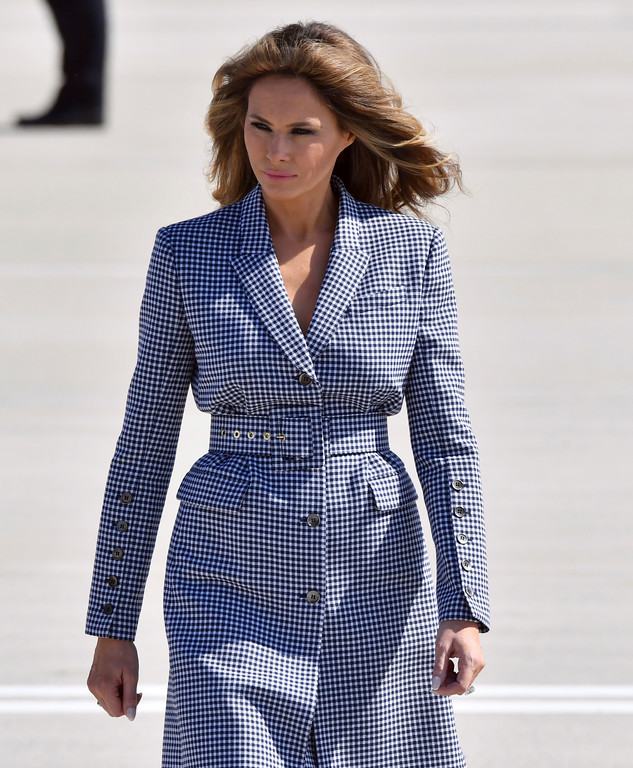 . FILE - In this Wednesday, May 24, 207 file photo, US first lady Melania Trump walks on the tarmac during arrival at Melsbroek Military Airport in Melsbroek, Belgium. Trump wore a steady wardrobe of mostly black during President Donald Trump\'s overseas tour, including a prim black lace dress with a matching mantilla headcover that she wore to meet Pope Francis and a dark jacket with golden detailing on the cuff and collar that she wore for her arrival in Italy, both by Milan designers Domenico Dolce and Stefano Gabbana. (AP Photo/Geert Vanden Wijngaert, File)