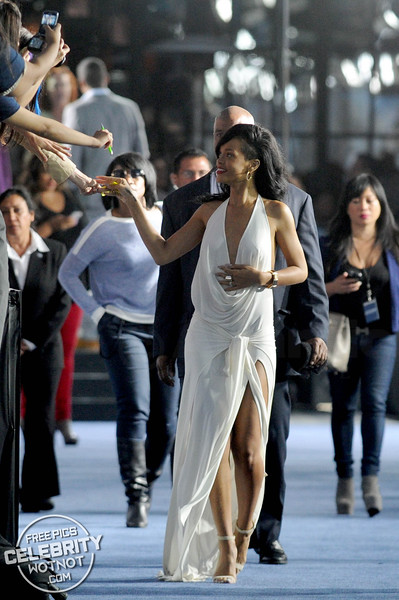 Rihanna Gives Fan A High-Five In Revealing Designed Dress