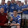 Former Shamrocks hurling great Dinny Ward presents the Sean Hollywood Cup to St Galls captain Terry Austin, 05W13S35.