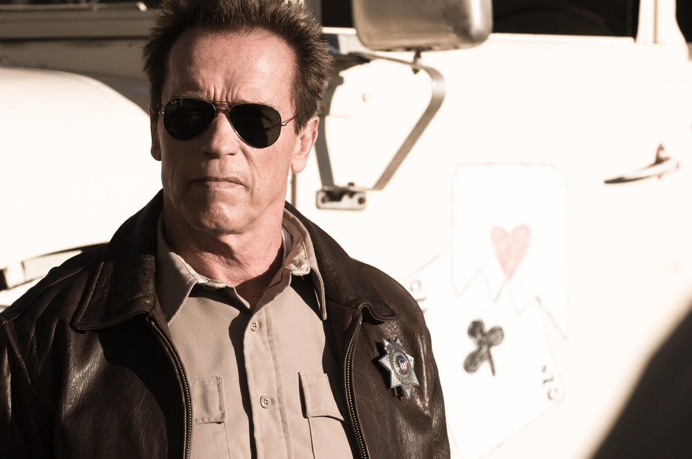 Description of . This film image released by Lionsgate shows Arnold Schwarzenegger in a scene from,