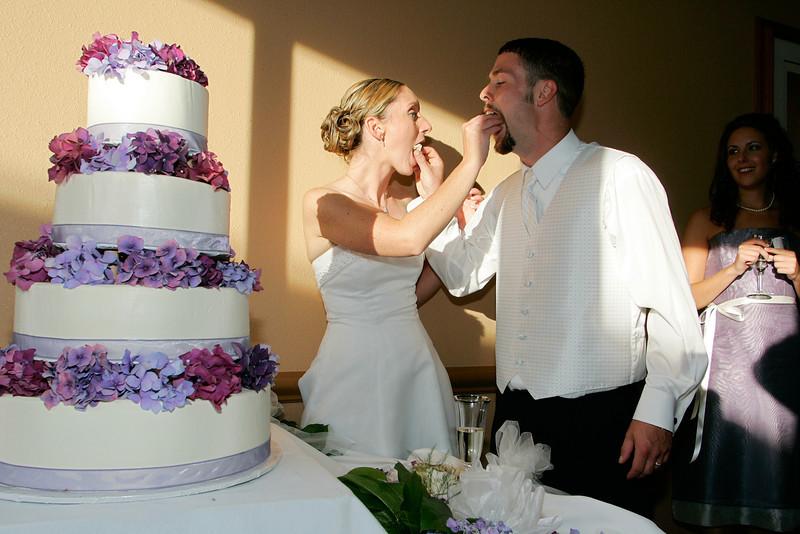 Jen and Kris sample the cake.