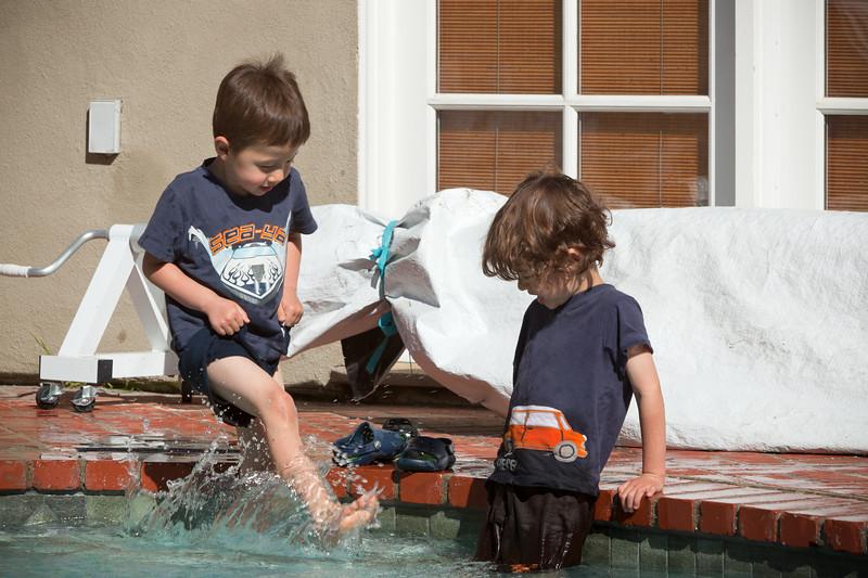 Caleb starts kicking water at his brother