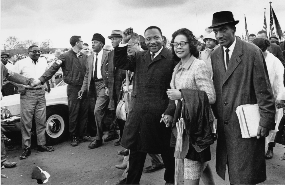. Dr. Martin Luther King Jr., third from right and his wife, Coretta King, lead off the final lap to the state capitol at Montgomery, Ala. in this March 25, 1965 file photo. Thousands of civil rights marchers joined in the walk, which began in Selma, Ala., on March 21, demanding voter registration rights for blacks. Rev. D. F. Reese, of Selma, is at right. King\'s birthday will be observed nationally Monday, Jan. 21, 2002.  (AP Photo/File)