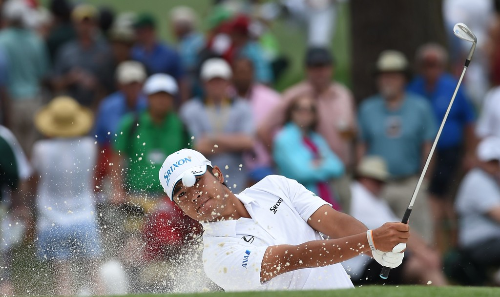 . Hideki Matsuyama of Japan hits out of the sand on the 7th hole during Round 4 of the 79th Masters Golf Tournament at Augusta National Golf Club on April 12, 2015, in Augusta, Georgia. DON EMMERT/AFP/Getty Images
