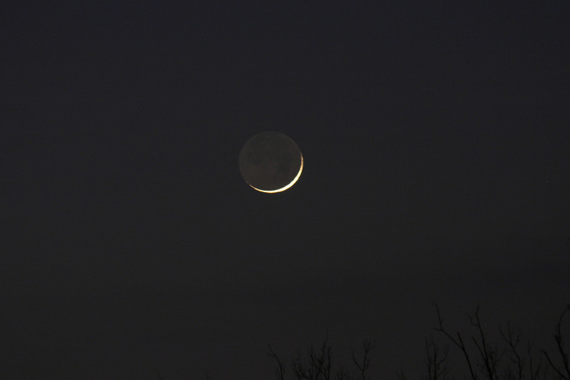 Dan McKeel captured this image of the crescent moon on Jan 5, 2011. Dan used a digital Canon 300D Rebel camera with a non digital 300mm Pentax Lens telephoto lens becomes 480 mm, 3 sec at F-5.6.
