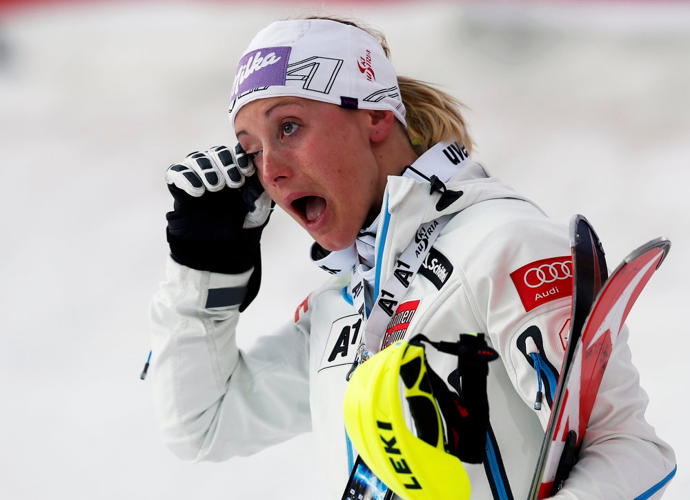 . Second placed Michaela Kirchgasser of Austria wipes her eye on the podium after the women\'s Slalom race at the World Alpine Skiing Championships in Schladming February 16, 2013.     REUTERS/Leonhard Foeger