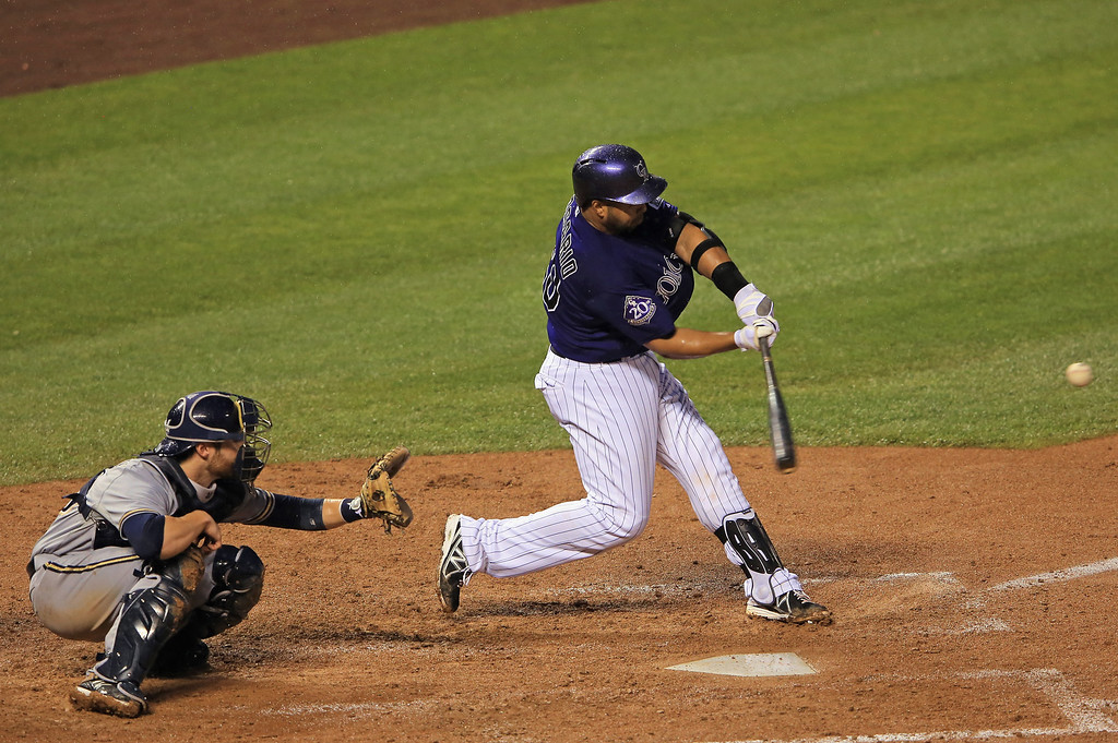 . DENVER, CO - JULY 27:  Wilin Rosario #20 of the Colorado Rockies hits a three run home run off of starting pitcher Tom Gorzelanny #32 of the Milwaukee Brewers in the sixth inning at Coors Field on July 27, 2013 in Denver, Colorado.  (Photo by Doug Pensinger/Getty Images)